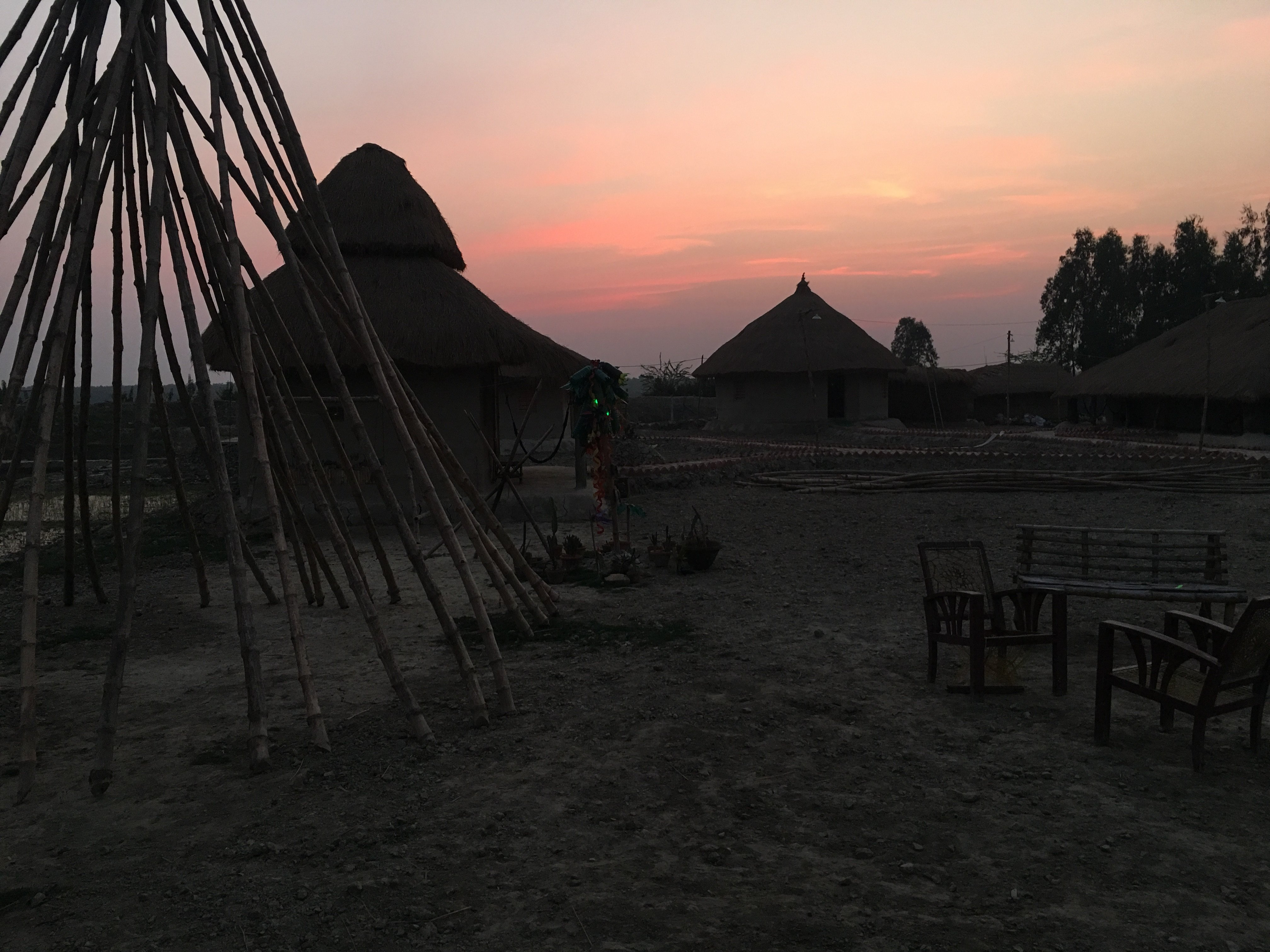 Sun setting behind the ecovillage on