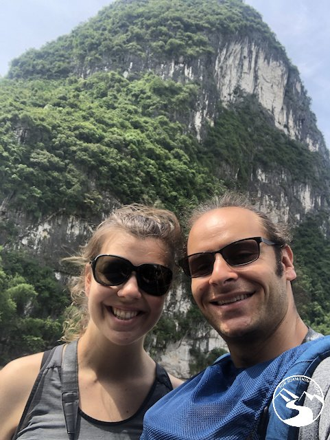 There are large limestone cliffs along the Li River boat cruise to Guilin China