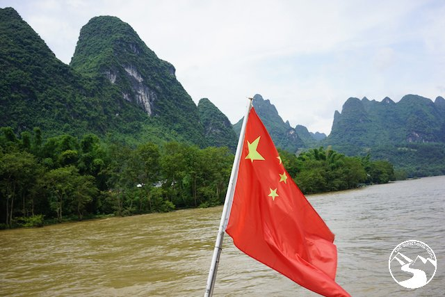 A mainland Chinese flag flys on the Li River boat cruise when we were traveling from Hong Kong to Guilin for a weekend