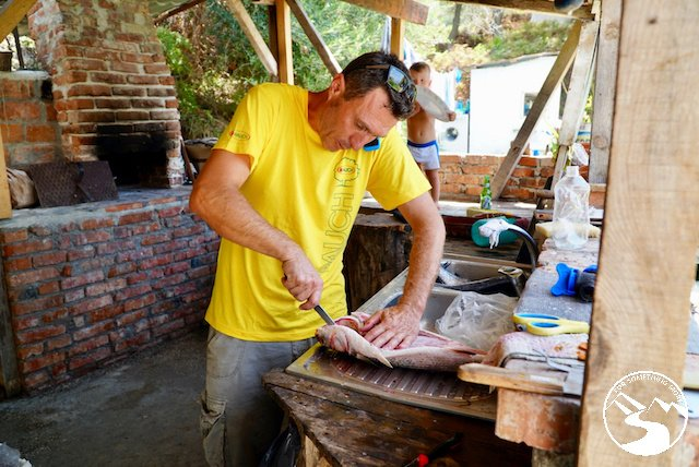 fresh fish being cut up at The Old Anchor restaurant in Albania