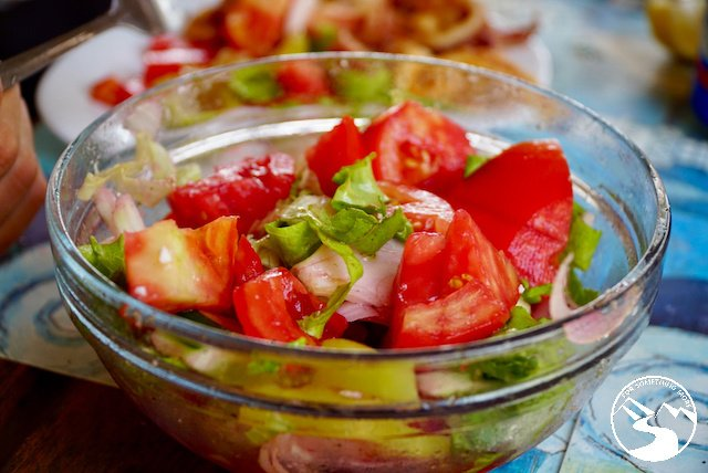 a delicious fresh salad with tomatoes and lettuce