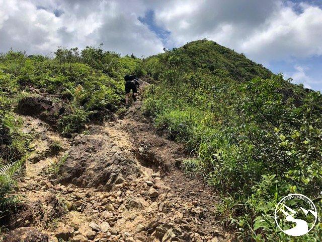 scrambling up rocks to the summit