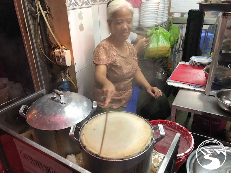A woman steaming crepes