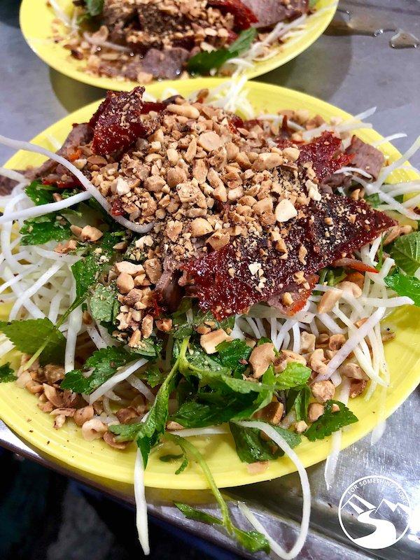Nom Bo (papaya salad) is one of the best street food in Hanoi
