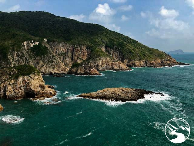 Cliffs and turquoise water you'll see when you hike Tung Lung Island