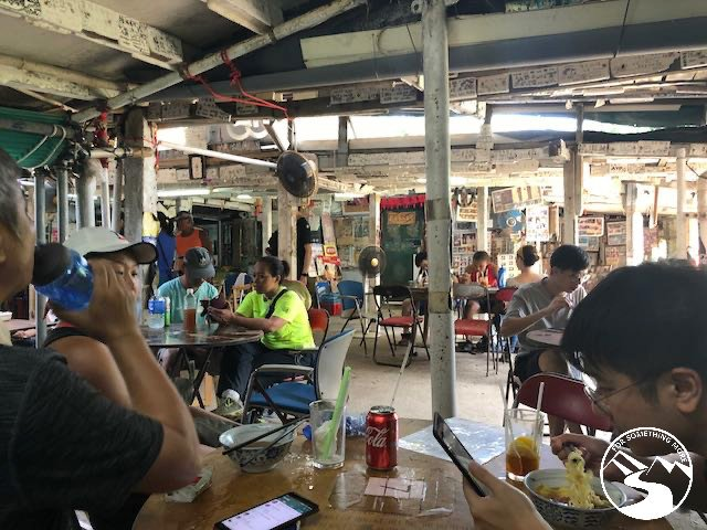 people eating noodle soup at the south garden store after hike Tung Lung Island