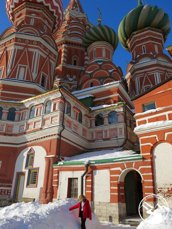 Stripy, swirly, snow topped St Basil's Cathedral while traveling to Moscow with kids