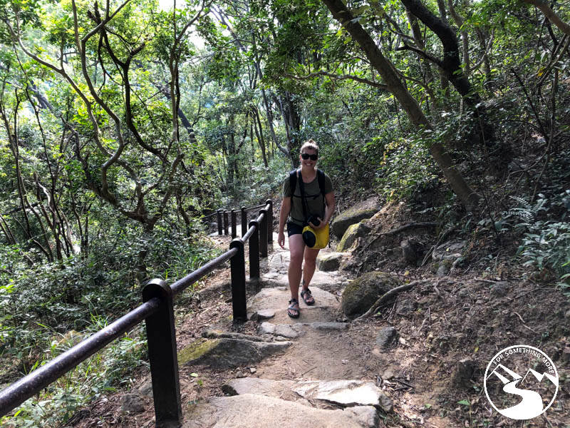 woman hiking up stairs on Lion Rock