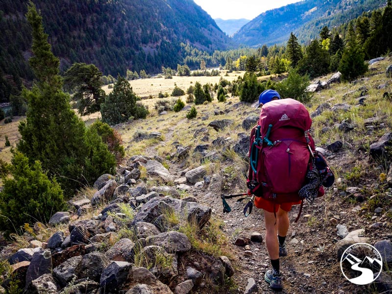 person backpacking through the Black Canyon in Yellowstone National Park