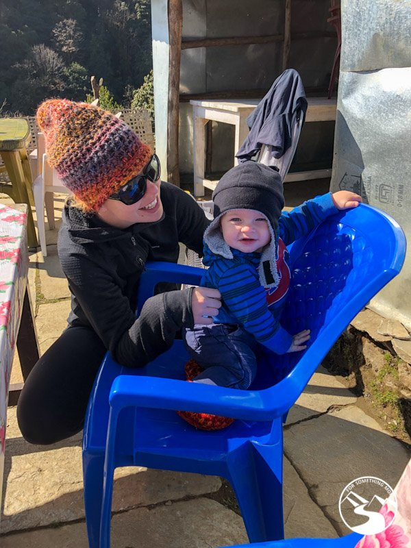 baby playing on a chair in the sun