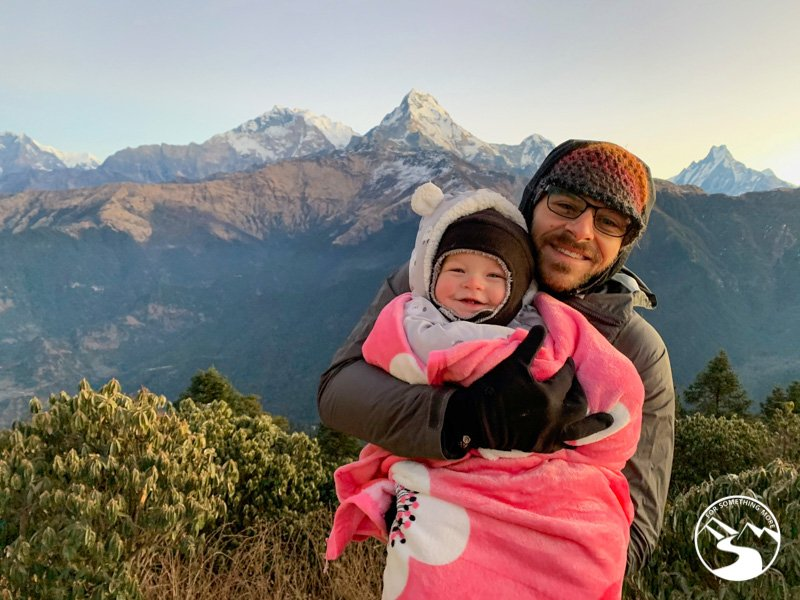 father holds baby at the summit of Ghorepani Poon Hill