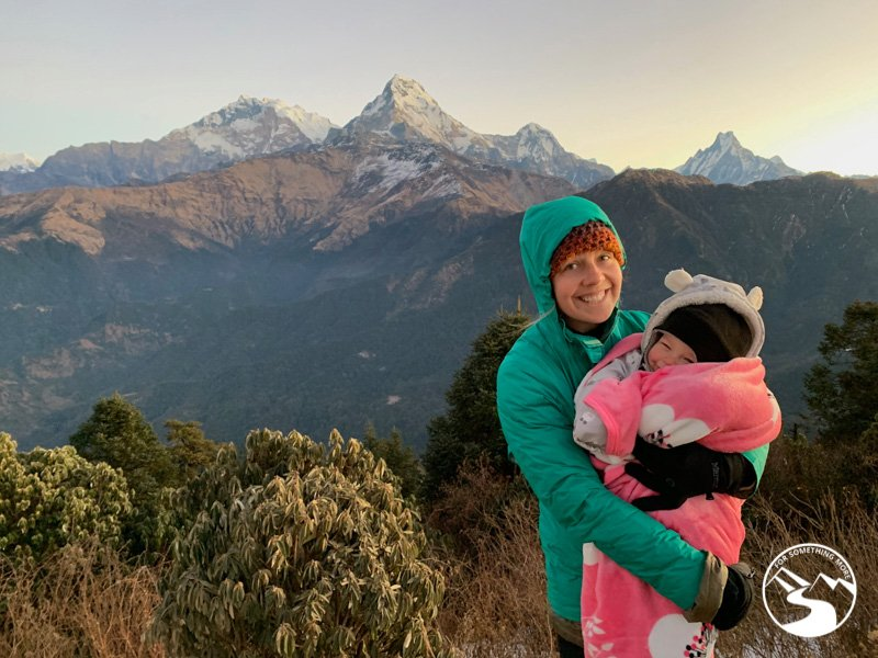 mother holds baby at the summit of Ghorepani Poon Hill