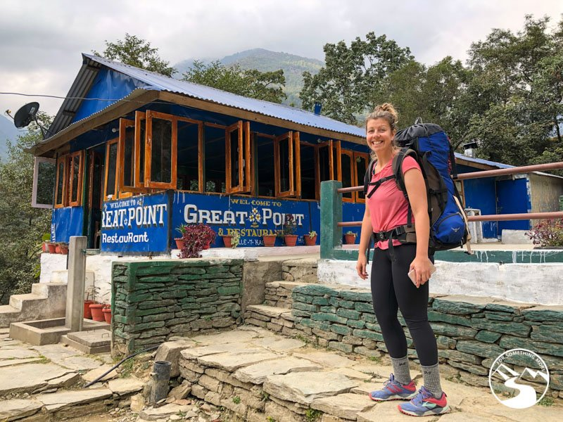 A woman smiling at Great Point restaurant on a Ghorepani Poon Hill Trek