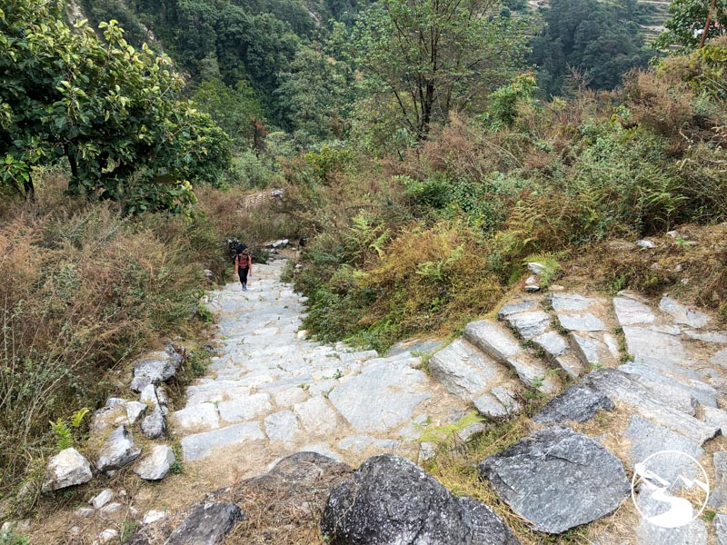 woman walking up steep path
