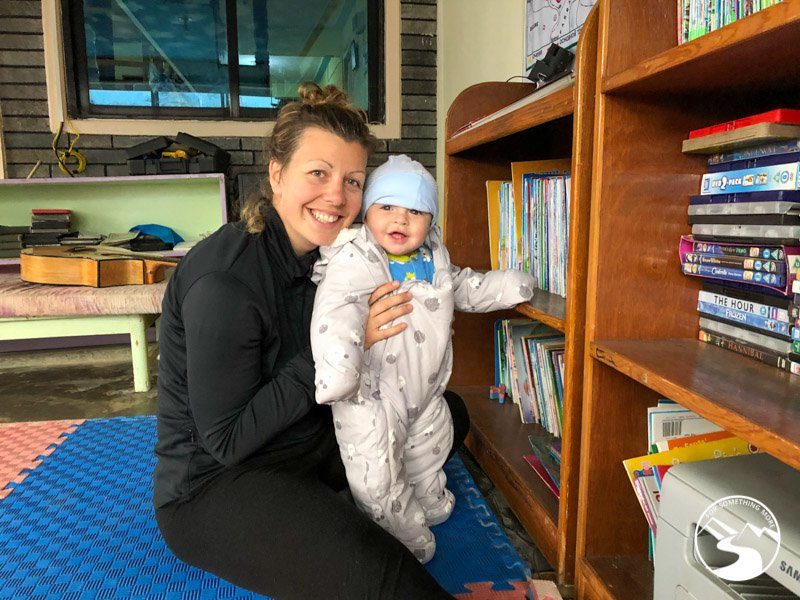 Woman playing with baby in a trekkers lodge