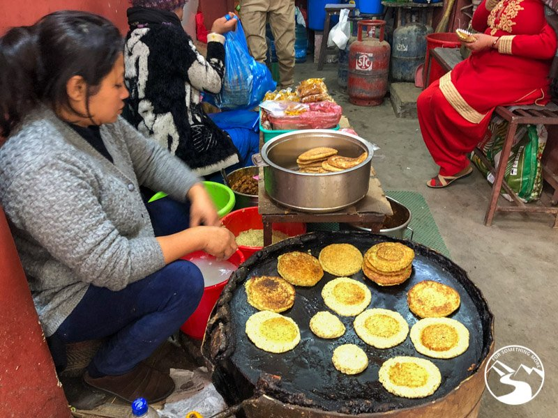 A woman cooking Nepal street food