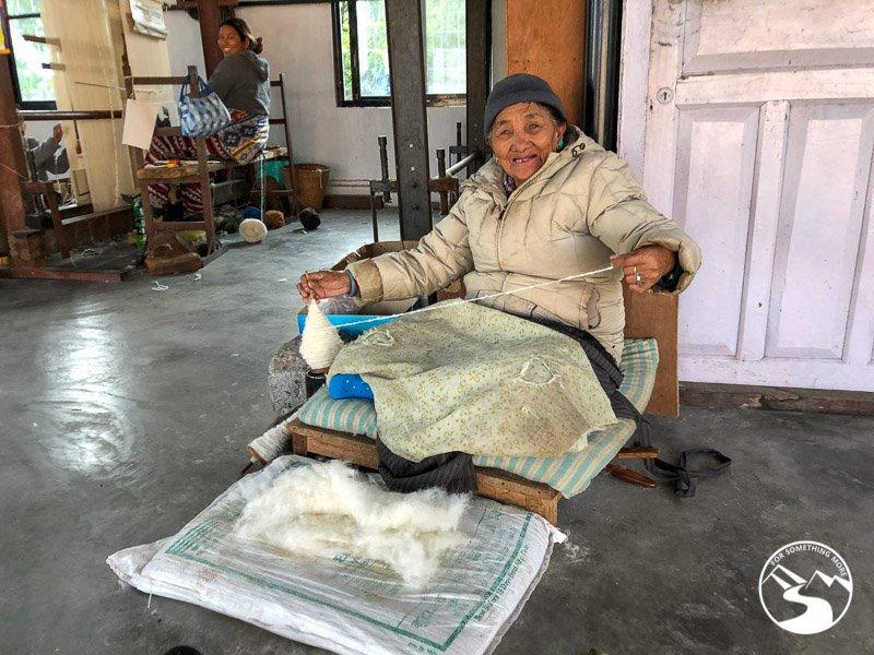 a woman making yarn