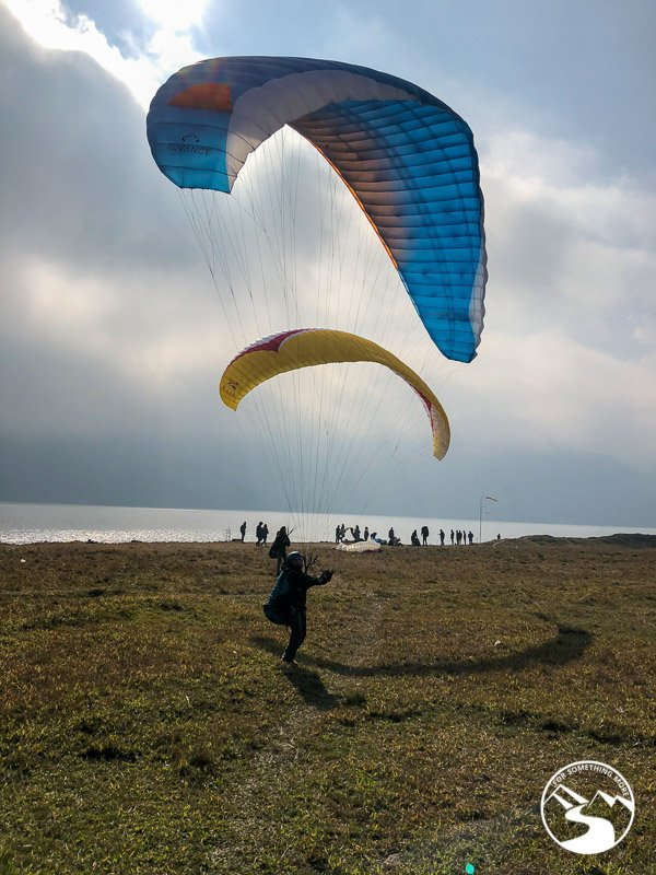 watching paragliders land is one of the things to do in Pokhara