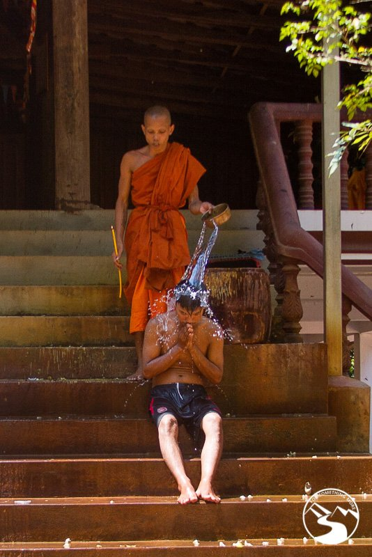 monk performs a water blessing while we were biking in Siem Reap
