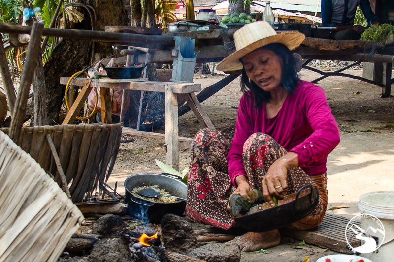 a woman cooks us lunch while we are biking in Siem Reap