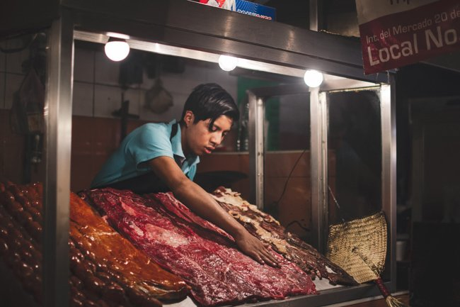 man selling dried meat