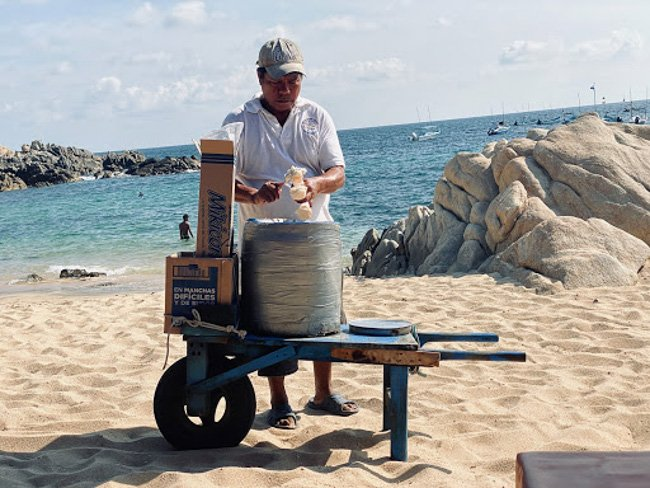 things to do in oaxaca a coconut ice cream vendor on the beach