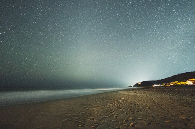 beach at night with starry sky