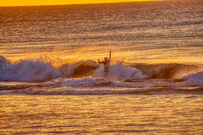playing in the waves at sunset at La Bocana Beach