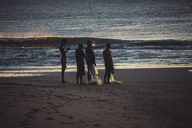 men in evening at La Bocana Beach