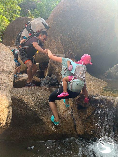 a family climbing up madai stream