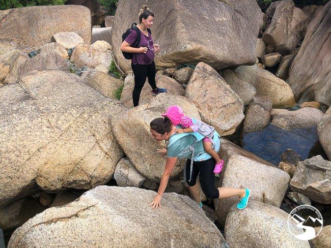 moms carrying kids up Madai Stream
