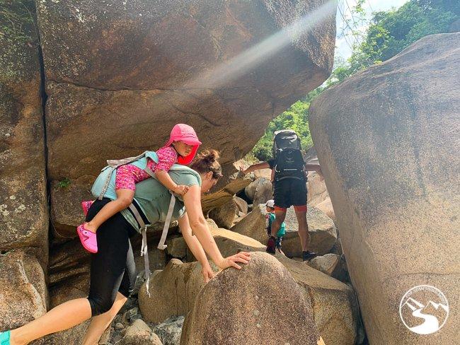 family climbing up to Tai Shui Hang Waterfalls