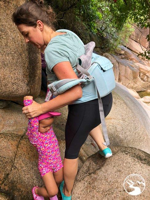 mom carrying baby up madai stream