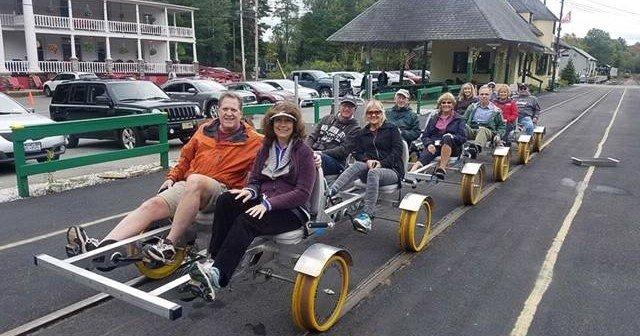 People riding on railbikes
