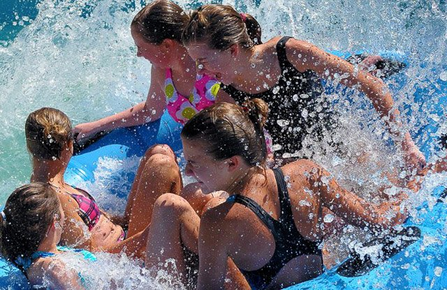 A family cooling off at Enchanted Forest Water Safari in Old Forge, New York