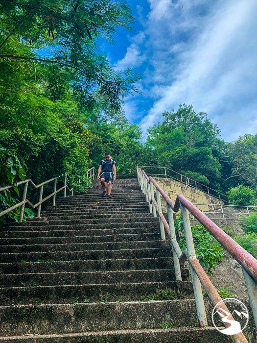 hiker walking down stairs