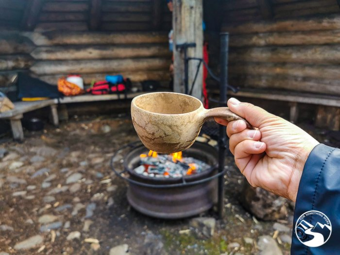 hot drink in a Finnish kuksa during one of the day trips in Lapland Finland