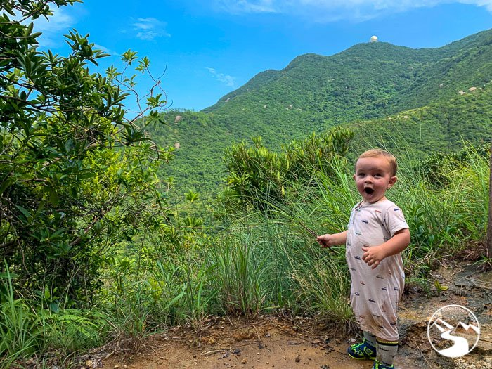 boy standing in mountains