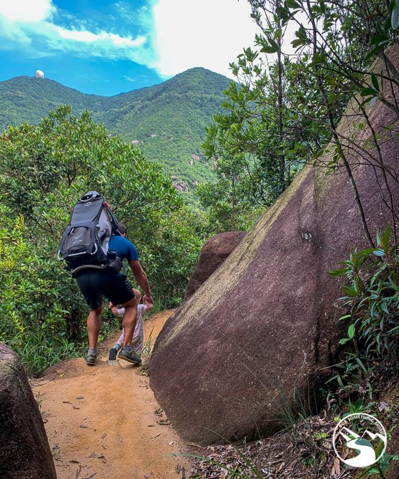 father helping son on Hong Pak Country Trail