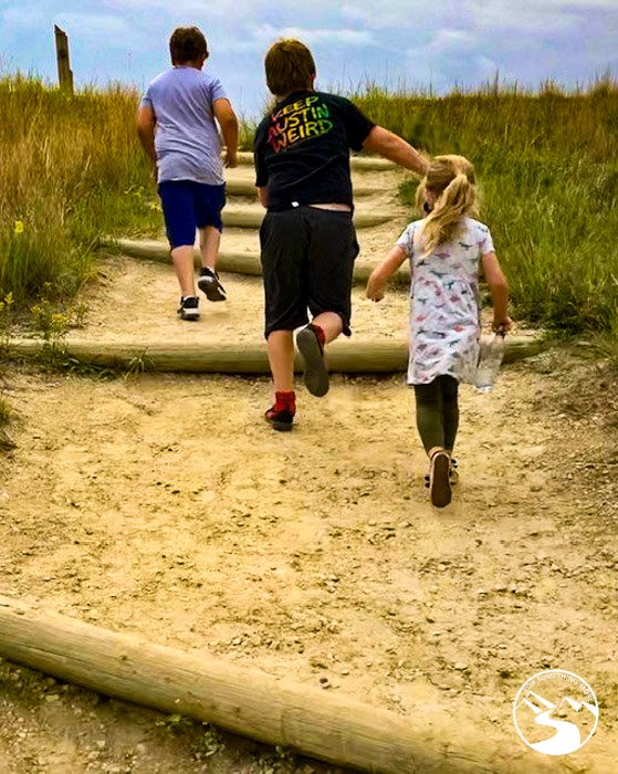 Theodore Roosevelt National Park With Kids running up stairs