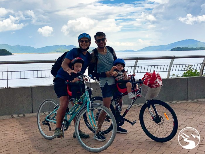 two dads and two children enjoy family friendly cycling in Hong Kong