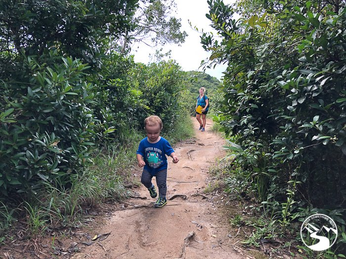 young boy running on dirt trail on Lung Ha Wan Country Trail (龍蝦灣)