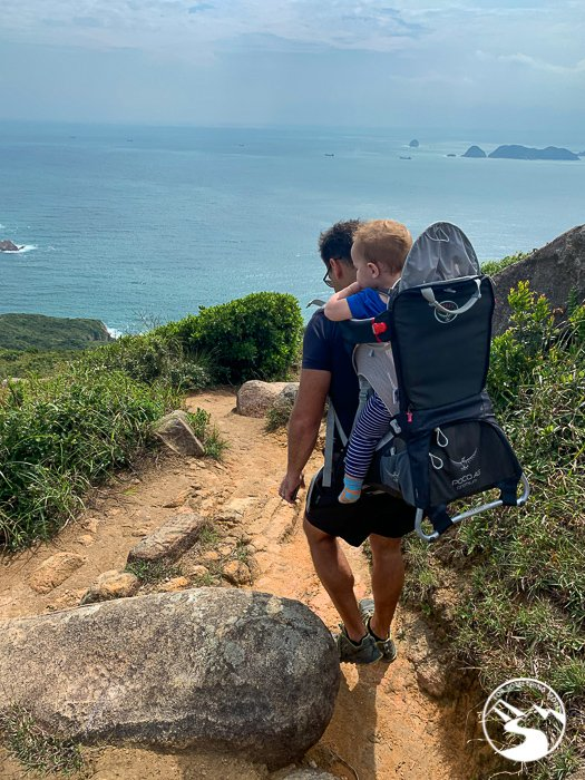 man hiking in hong kong with son
