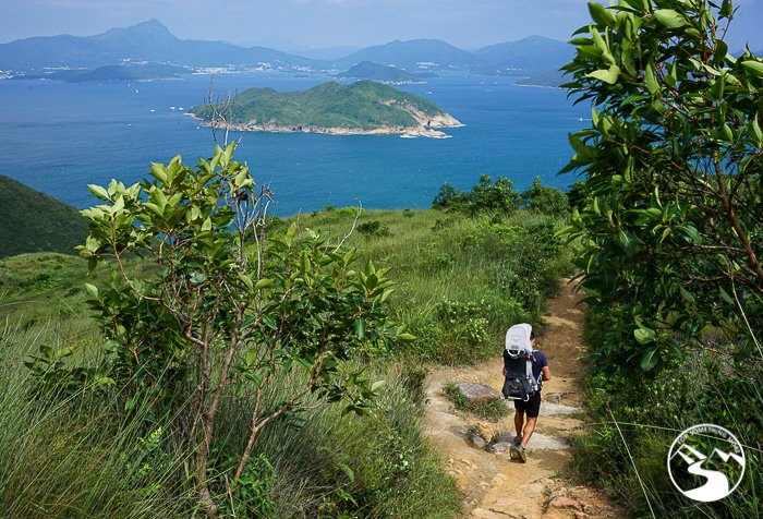 man with son on his back hiking north on the Lung Ha Wan Country Trail (龍蝦灣)
