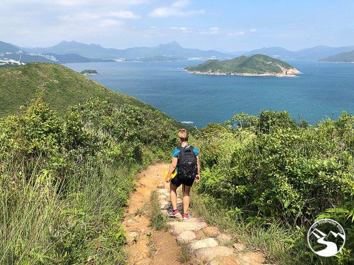 woman hiking down hill on Lung Ha Wan Country Trail (龍蝦灣)