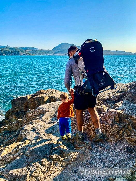 man and son on rocks near siu sai wan promenade