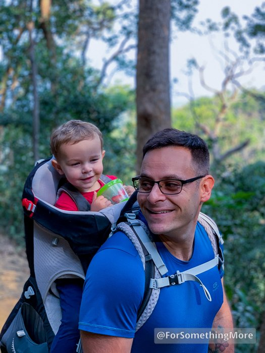 father carrying son in osprey poco plus