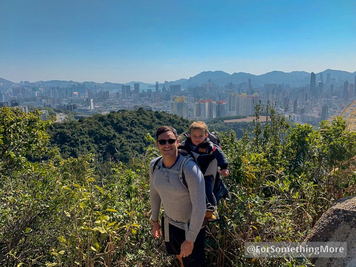 man with toddler in hiking backpack on the Eagle's Nest Nature Trail (鷹巢山)