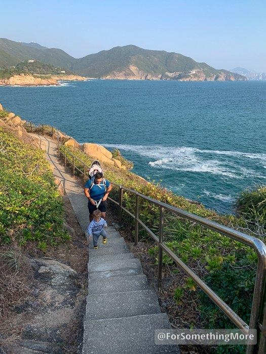 man and boy hiking on Tai Tau Chau