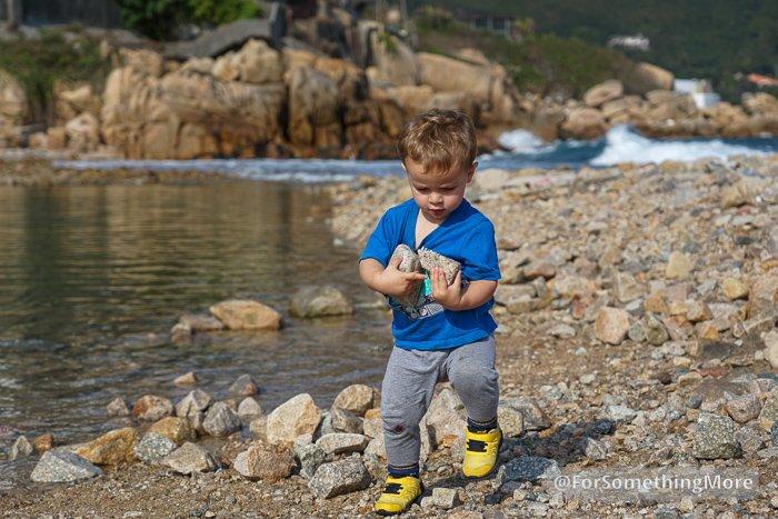 boy playing on shoreline